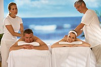 Man and woman receiving massages