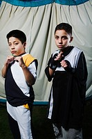 Two boys 9-11 holding up fists, portrait
