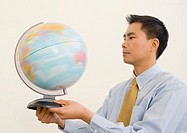 Businessman spinning globe