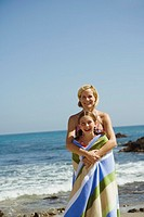 Mother and daughter together at the beach