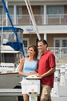 Couple standing on dock