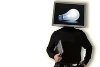 Businessman with laptop displaying a lightbulb