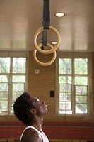 Gymnast looking up at rings