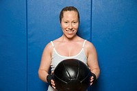 Woman holding exercise ball