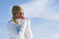 portrait of teenage girl in winter warming her hands