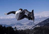Man snowboarding vert
