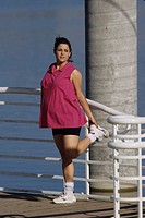 Pregnant woman exercising outdoors