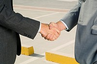 Two businessmen shaking hands (thumbnail)