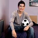 A teenage boy with a football