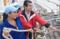 Couple untying ship's rigging