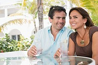 Couple having drinks outdoors