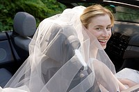Bride in a convertible