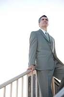 A businessman standing on the top of a flight of steps