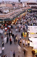 High angle view of a large group of people walking in a market