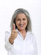 Senior woman making hand gesture, thumbs up