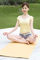 A Young Woman Practicing Yoga, Front View