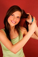 A young woman applying hairspray (thumbnail)