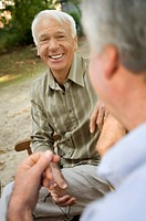 Two elderly men having a laugh