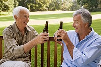Two elderly men having beer