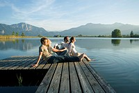 Two couples relaxing on a pier