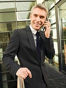 A businessman talking on his mobilephone