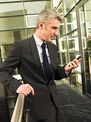 A businessman checking his mobilephone