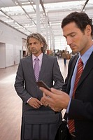 Two businessmen at the airport