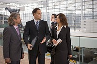 Business people chatting at the airport