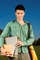 A teenage boy carrying school books