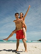 Man carrying girlfriend on back