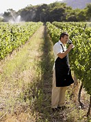 A man drinking wine at a vineyard