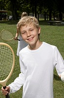 A boy holding a tennis racket