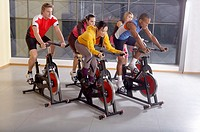 People on the cycles in the gym