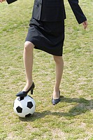 Businesswoman´s Foot on a Ball, Front View