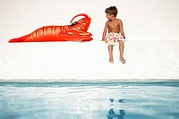 Boy Standing Looking at Lobster Raft