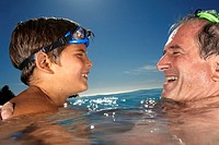 Grandfather and Grandson Swimming