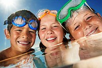 Kids Wearing Swim Goggles in Pool