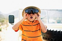 Boy on Safari Looking Through Binoculars