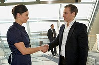 Businessman and a businesswoman shaking hands