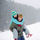 Playful Couple in Snow