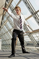 Businessman standing with his arm outstretched