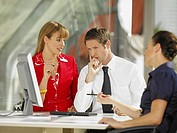 Businessman and two businesswomen discussing in an office