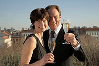 Mature couple holding champagne flutes