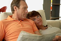 Close-up of a mature couple sitting on a couch