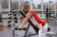 Man lifting weights at a gym