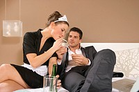 Businessman lighting a maid´s cigarette