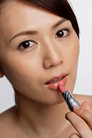 Close-up of Japanese Woman applying lipstick