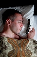 Man sleeping beside cell phone