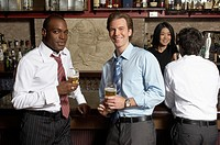 Businessmen sitting at bar