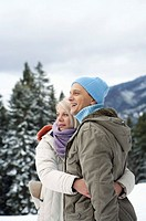 Couple wearing warm clothing embracing each other